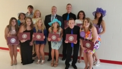 Kirby Easterling (back center) with Belfry scholarship recipients
