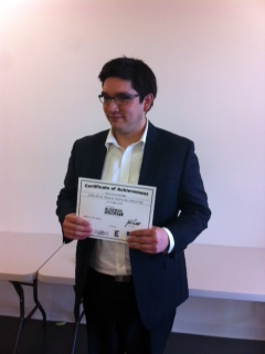 Colin Elrod accepts CBCC first place certificate