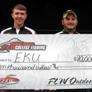 John Smith and Kyle Raymer with the 'big check'